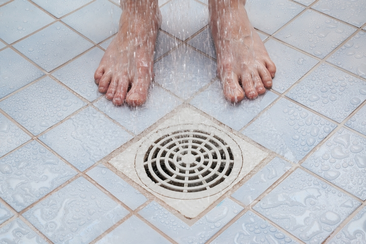 Pulling out the clog is one of the possible clogged shower drain solutions.