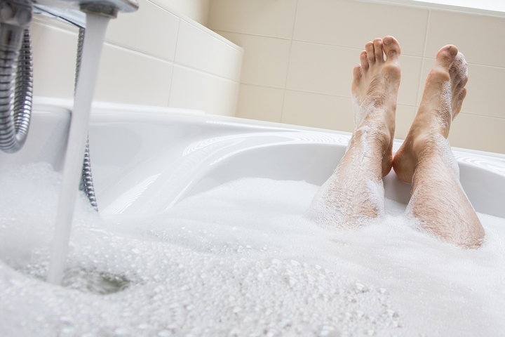 The soap scum may be the reason why your bathtub doesn't drain properly.