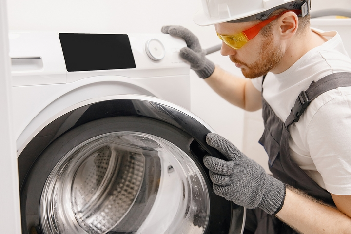 A clogged washing machine could cause water to back up into the sink.