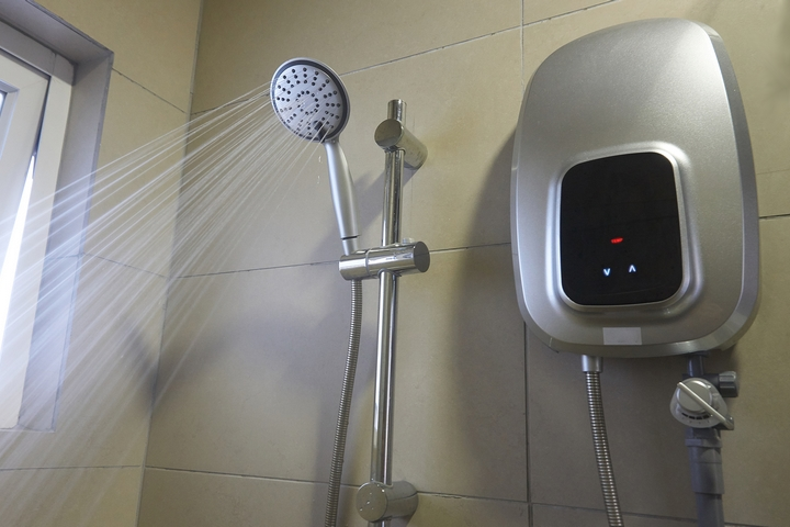 Your shower has a small tank storage heater.